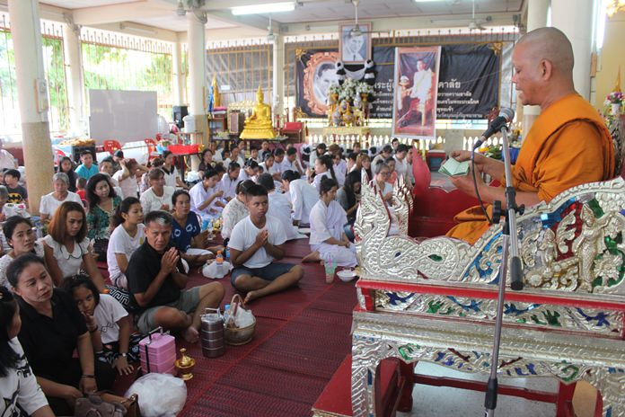Thailand is recognized as the administrative home of Buddhism. In the photo a monk reads teachings from Buddha to a gathering celebrating Visakha Puja. Typically families display the national flag and Buddhist Flag, light candles to the Buddha in a temple, offer alms, give to charity and prepare meals for the family. In the temple celebrants, pay respect to the monks, chant, meditate and listen to homilies.  http://www.pattayamail.com/wp-content/uploads/2017/05/1242-n21-Visakha5.jpg