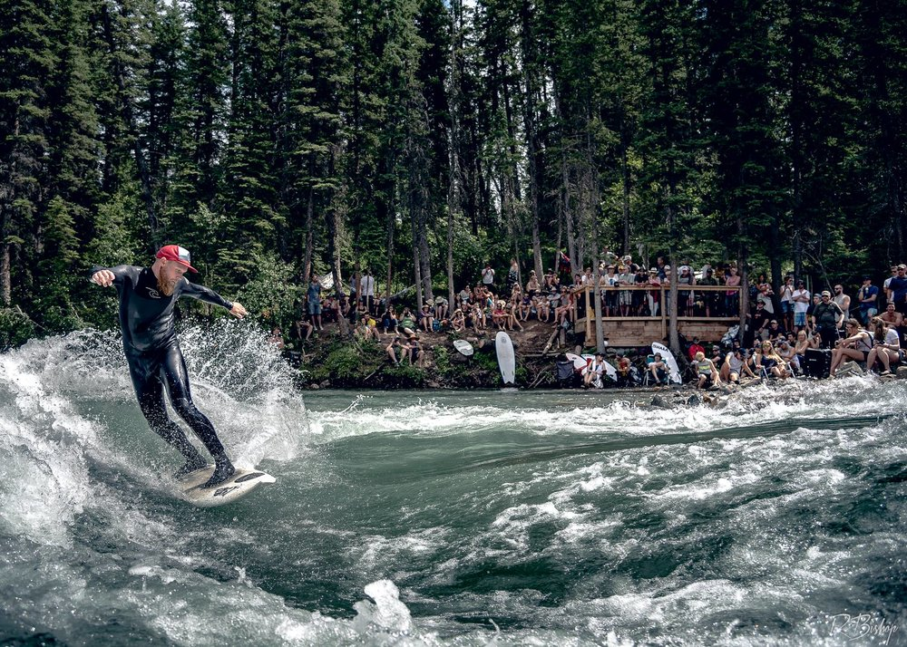 Matthew Robertson on The Mountain wave during the first North American River Surfing Championships in 2017.  Wave by the Alberta River Surfing Association &  Surf Anywhere . Photo by  Robert Bishop Photography .