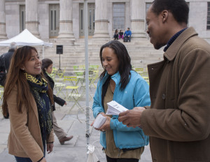 Directors of Full Force, Anginese Phillips & Kadeem Alston-Roman engaging with a member of the Brooklyn community at Brooklyn Borough Hall.