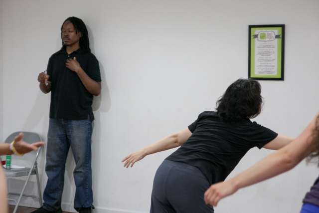 Co-Director of Full Force, Kadeem Alston-Roman Doing Energy Medicine During a Workshop.