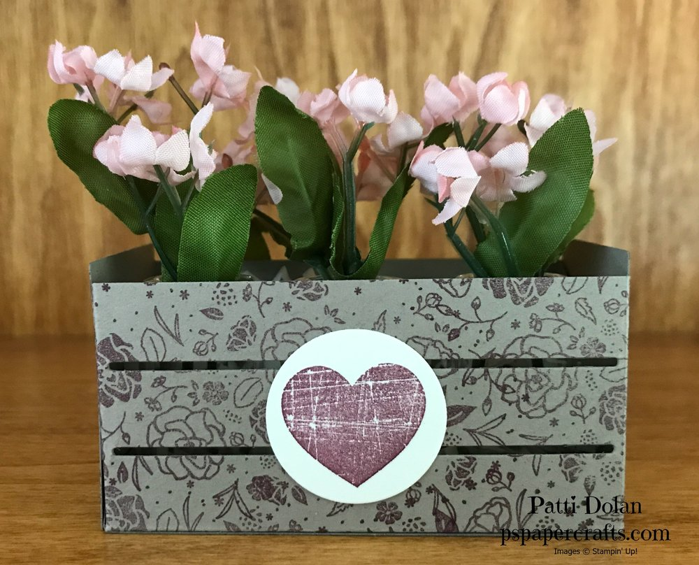 I cut the crate from Crumbcake Cardstock that we stamped with the flowers from the Wood Words set in Fresh Fig. I stamped the heart from the same set in Fresh Fig ink and cut it out using the Layering Circles and adhered it to the crate