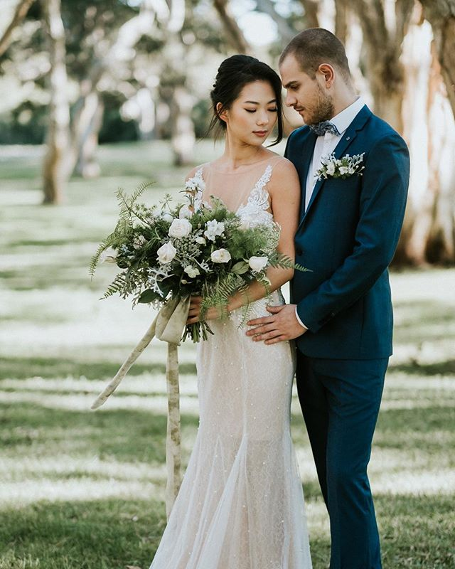 In your arms is where I want to be. WOODLAND REVERIE now on @modernweddingmagazine blog. Read all about it here 👉https://www.modernwedding.com.au/woodland-reverie-romantic-forest-shoot/  Concept, styling and flowers: @flowerswithelegance  Photography: @ballyhoophoto  Props styling: @npm_events  Gown: @emeraldbridal  MUA & Hair: @captivatebyellie  Cake: @bakeeatlovecakes  Stationary: @elkprints  Smile Design: @smilecosmeticau @smiledentistry_au  Wedding Planner: @luxeunforgettableevents  Models: @sarahsuuu @seblades  ____________________________________  #weddingstylist #bridalbouquet #weddingphotography #weddingdirectorysydney #weddingdecor #weddingsydney #bridestobe #sydneyflorist #floralcentrepieces #floralgarlands #bridesbouquet #forestelopement #gardenwedding #instabride #weddinginspiration #flowers  #weddingideas #gettingmarried #ido #tyingtheknot #floraldesigner #personalisedservice #weddingflowers #isaidyes #floralhappiness #photographyinspiration #modernweddings