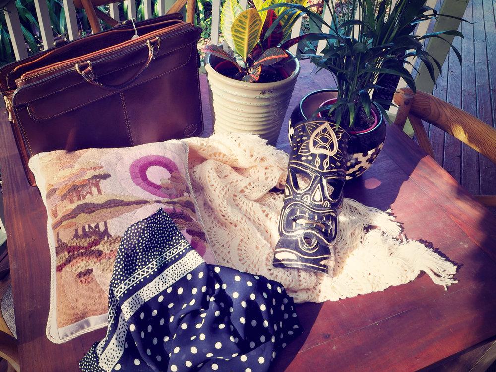 thrifted home decor - tiki mask, cushion, crochet, textiles