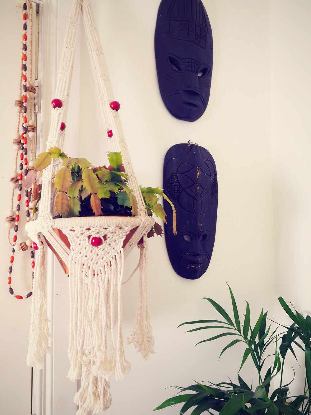 eclectic home decor - macrame hanging planter, tiki masks