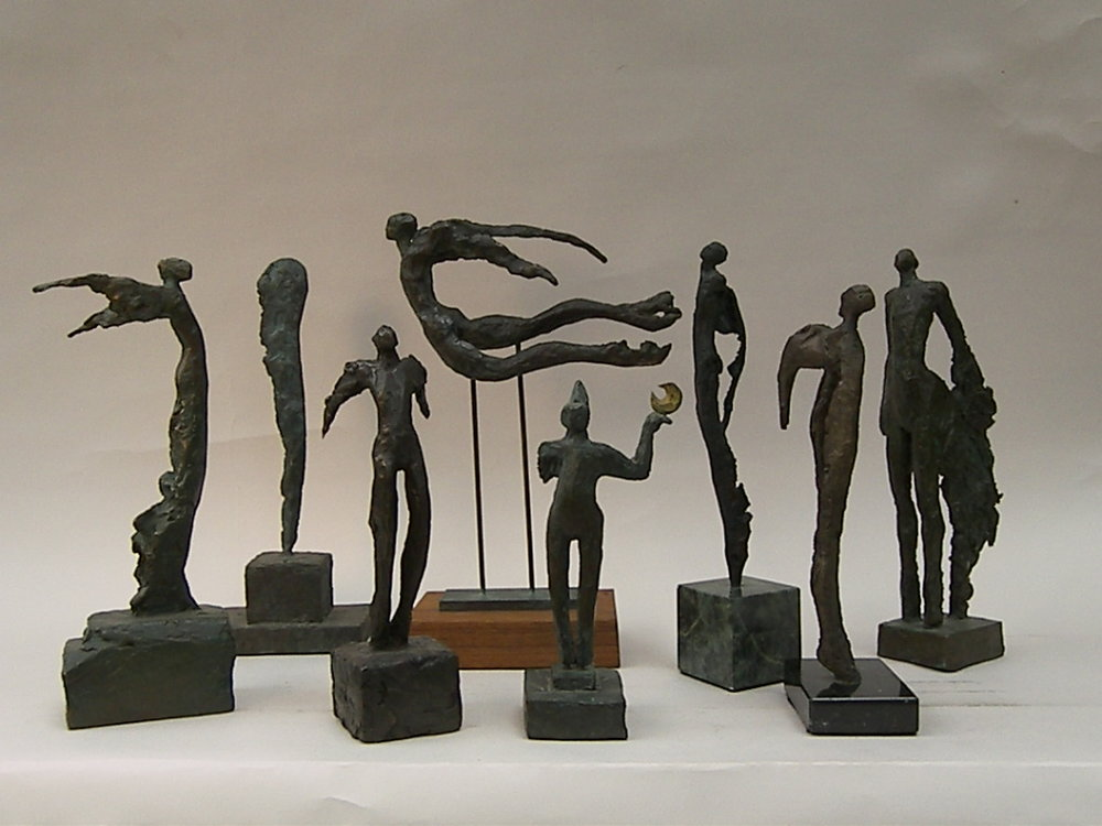 small bronze sculptures: Nikes & Winged Beings