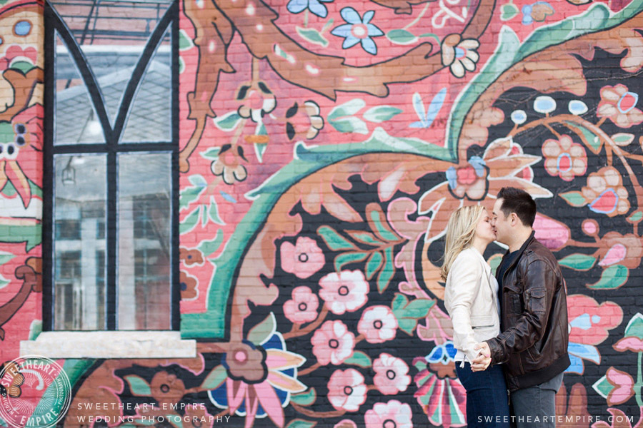 Engagement photos in front of mural