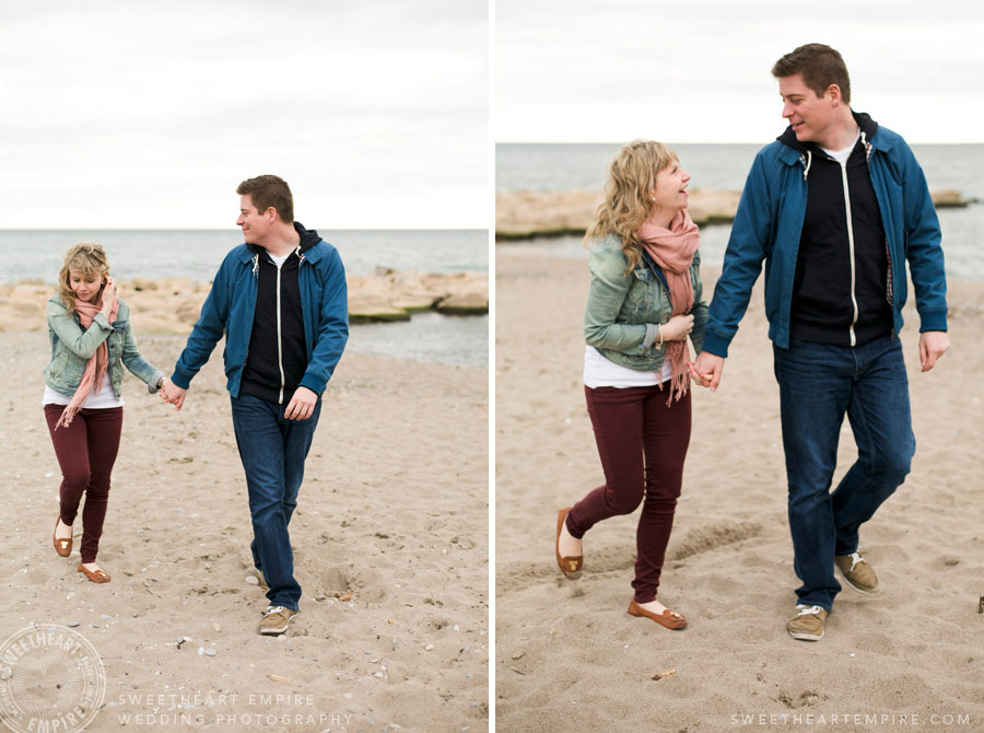 Vanessa & Mark strolling back to the boardwalk at the end of their Toronto Beach engagement session.