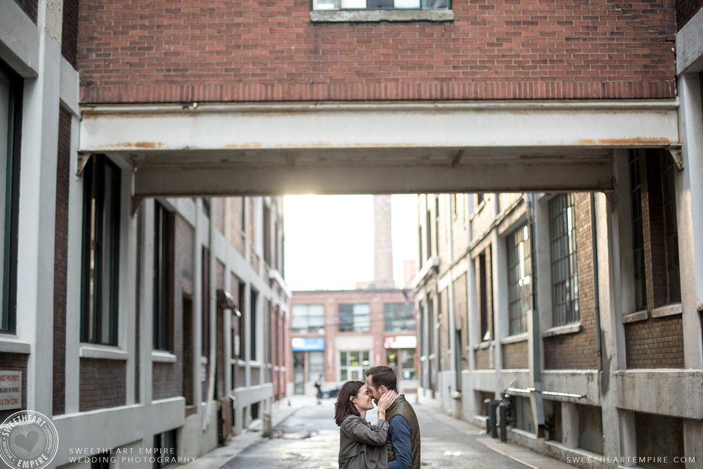 Couple kissing lovingly in an alleyway