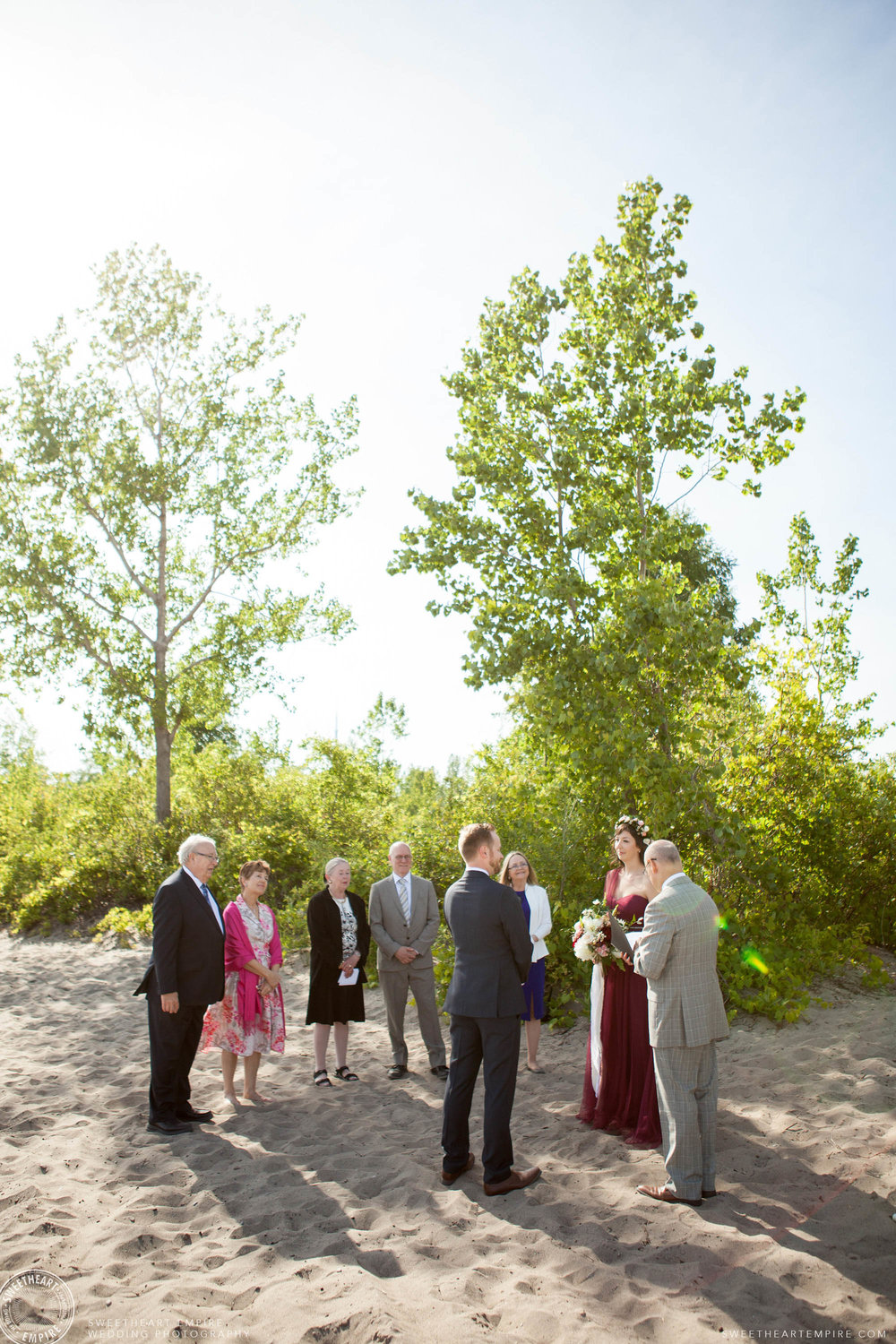 A small Toronto Island wedding ceremony on the beach.