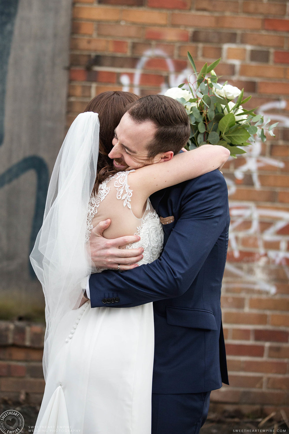 Groom hugs bride after their reveal at District 28 Wedding, Toronto.