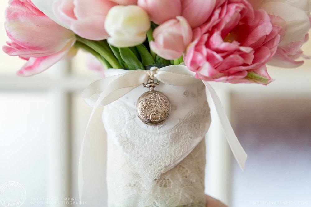 Grandmothers locket on bridal bouquet.jpg