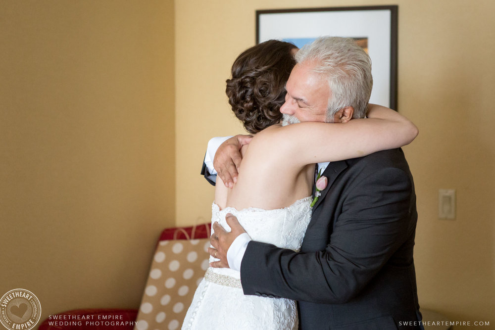 The bride hugging her father; Toronto Reference Library Wedding