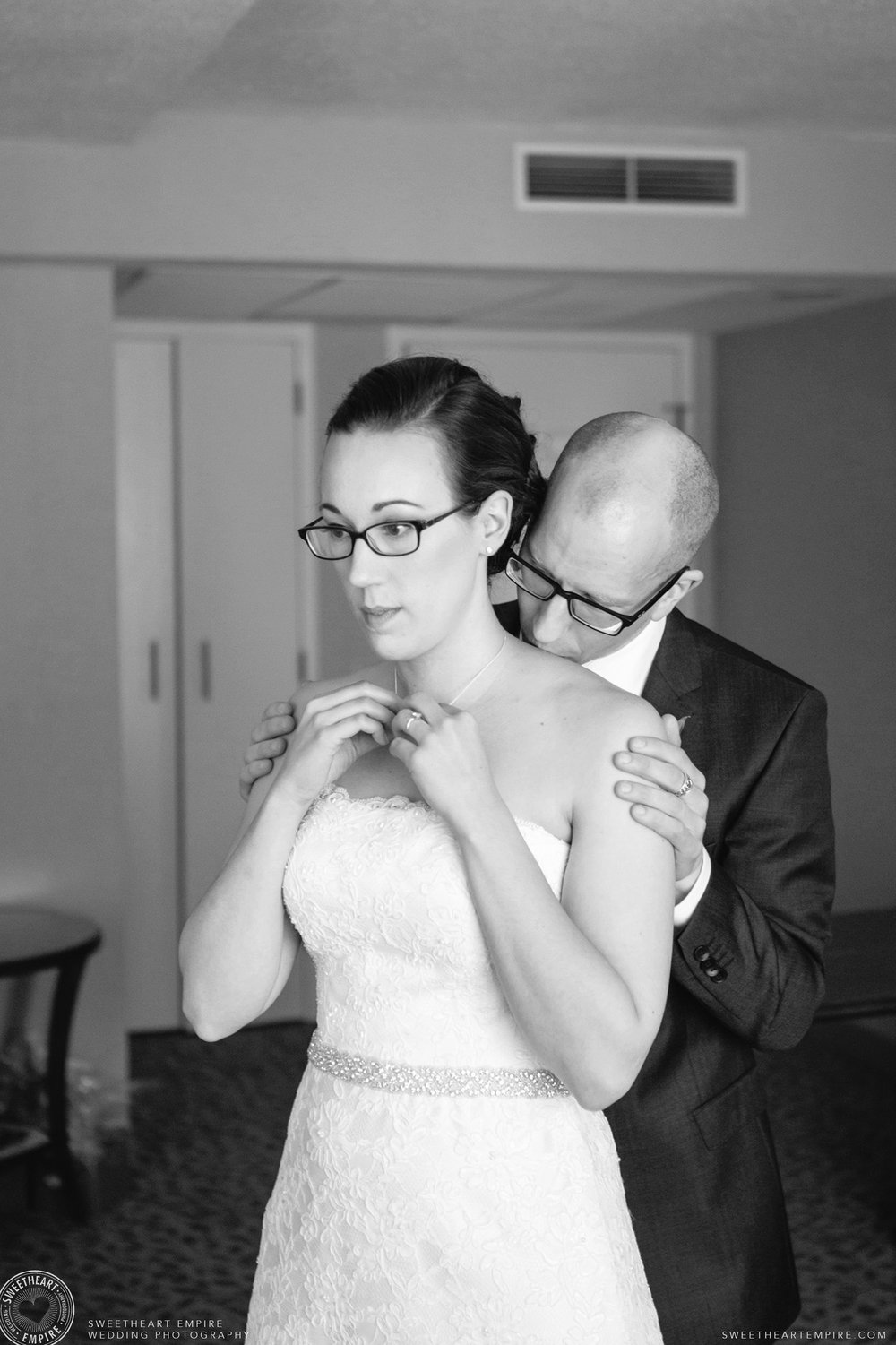 The groom kissing the bride's neck; Toronto Reference Library Wedding