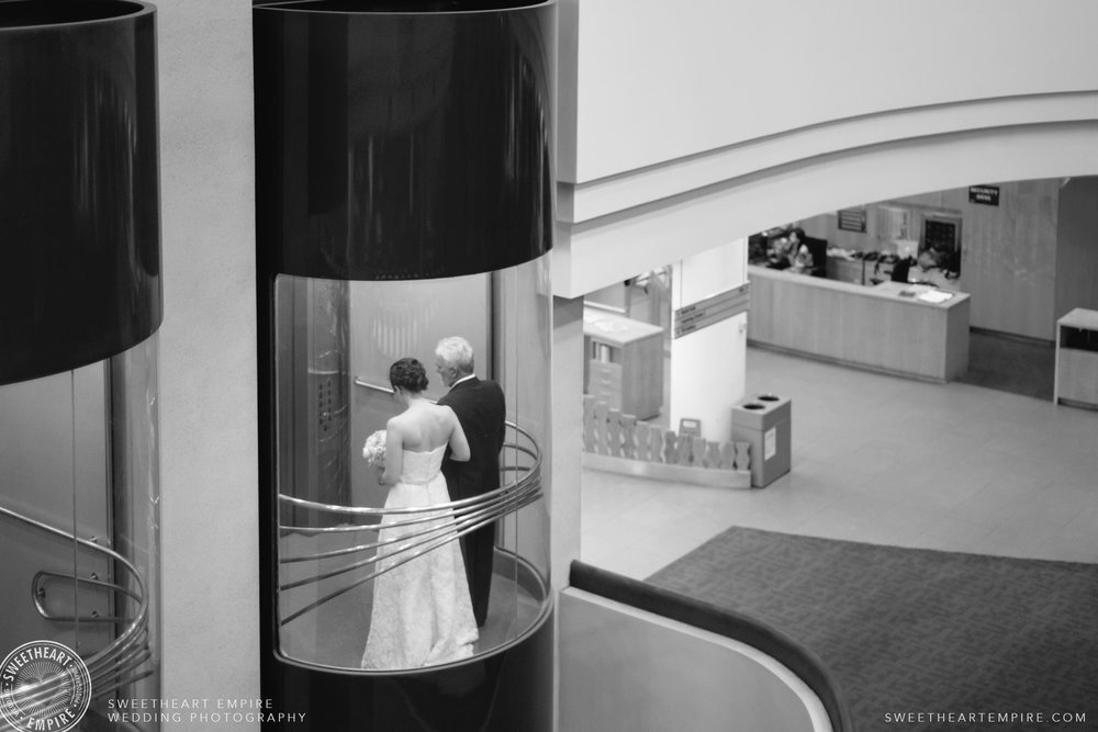 Bride and her father taking the elevator up to the ceremony; Toronto Reference Library Wedding