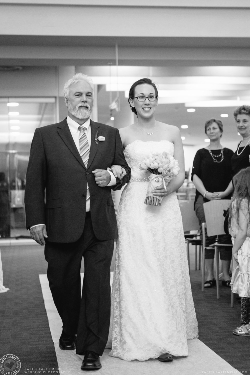The bride walking down the aisle with her father; Toronto Reference Library Wedding