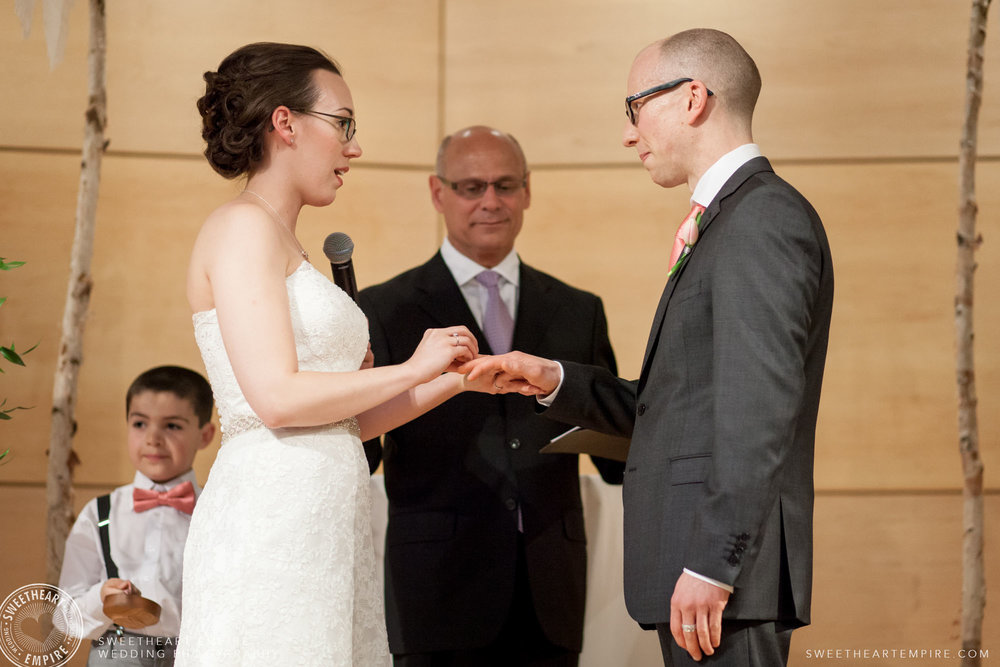 Bride and groom exchanging vows; Toronto Reference Library Wedding