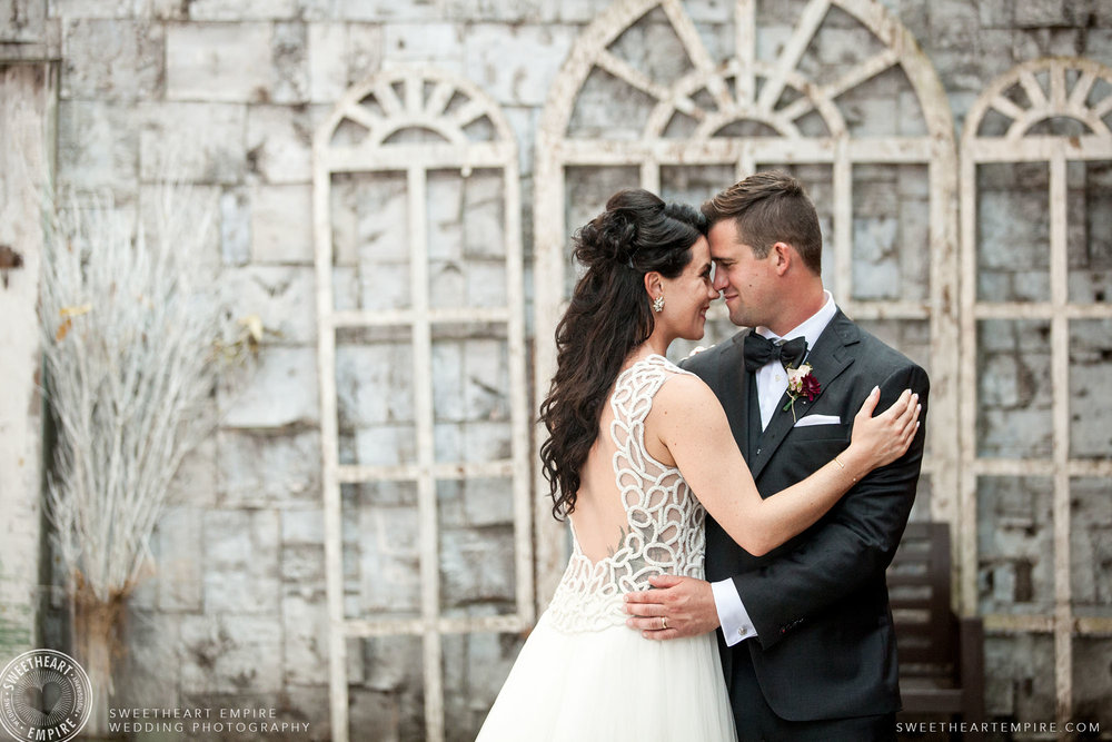 Lelania & Mike sharing a moment as newlyweds in the Berkeley Church courtyard.