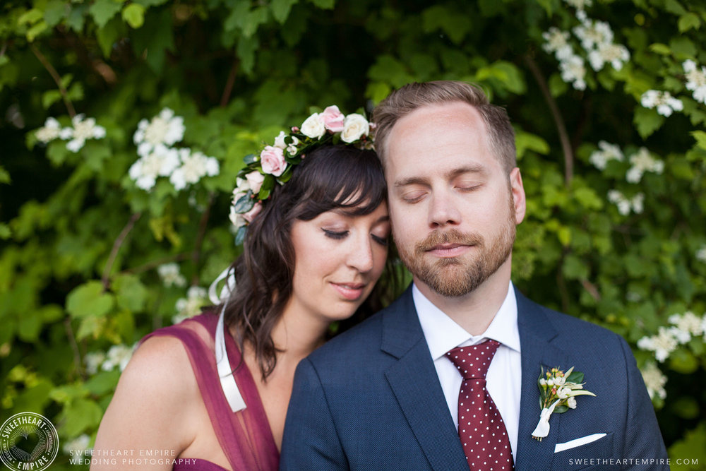 Laura wore a gorgeous magenta wedding dress and flower crown to her Toronto Island Wedding.