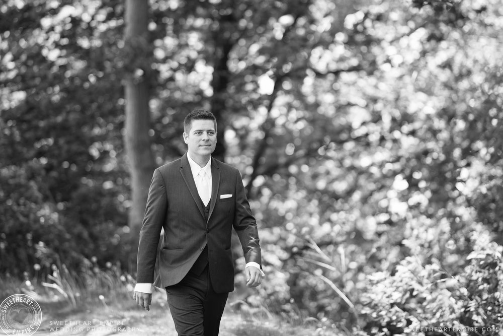 The groom walking the grounds of the Oakville Golf Club, getting ready to see his bride!