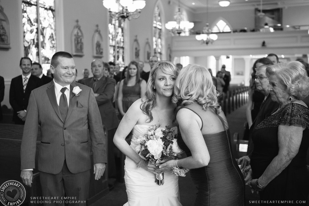 The bride gets emotional while her parents give her away, Oakville Golf Club Wedding