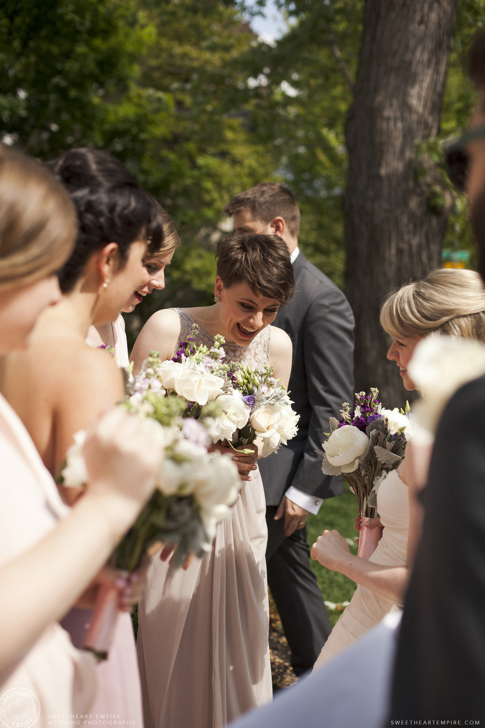 Happy bridesmaids mingling outside St Andrews Church Oakville.jpg
