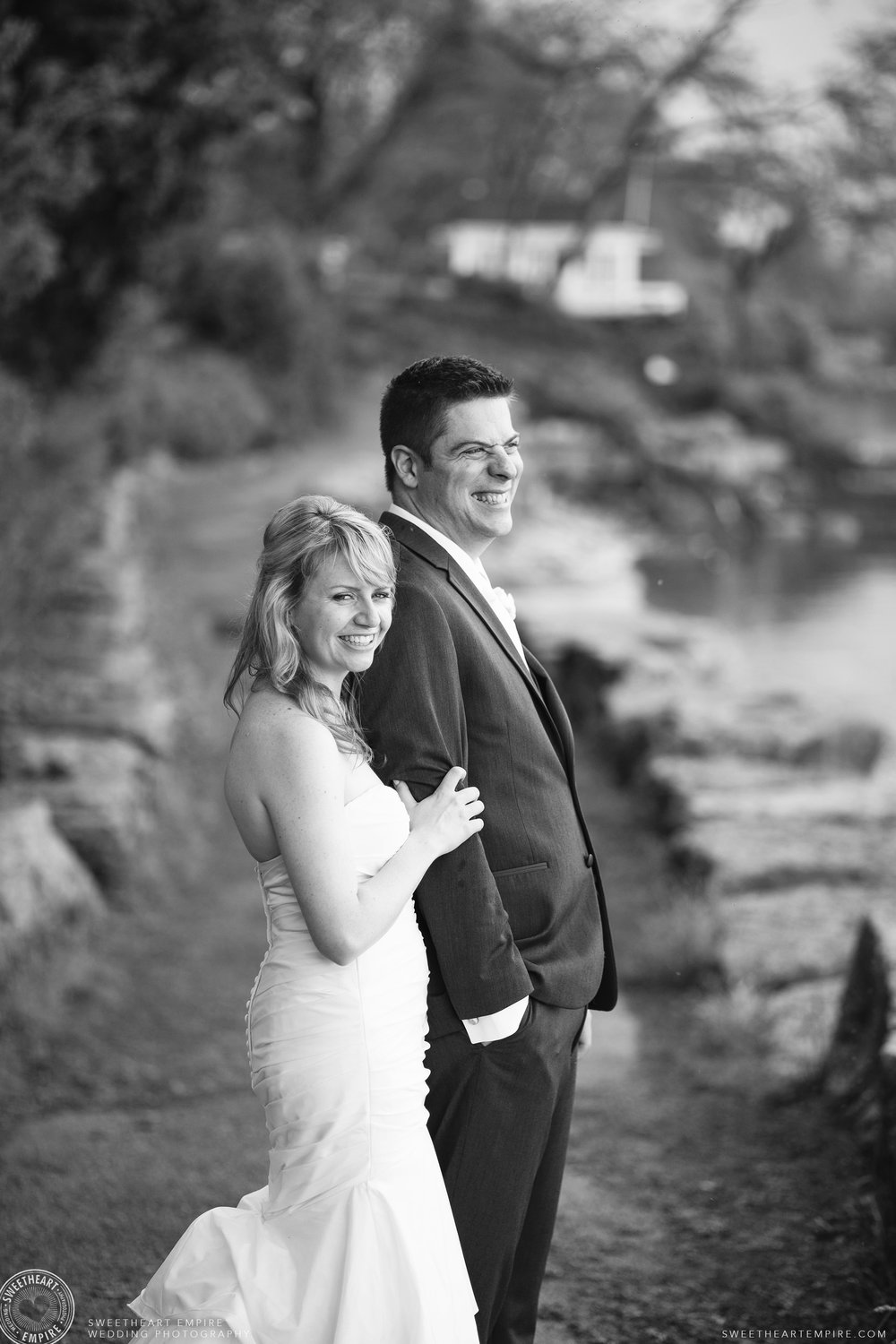 Bride and Groom along Oakville waterfront.jpg