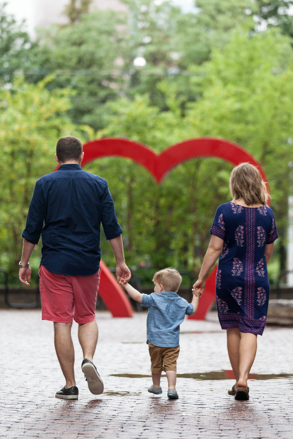 07_Family walking towards heart sculpture in distillery district.jpg