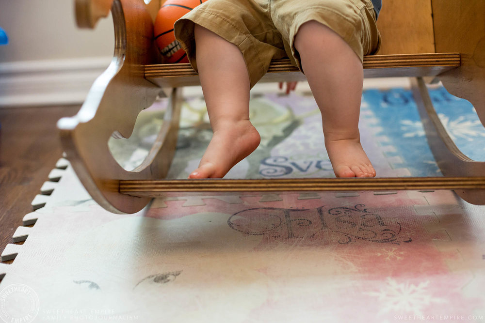 14_Close up of toddler's toes on rocking horse.jpg