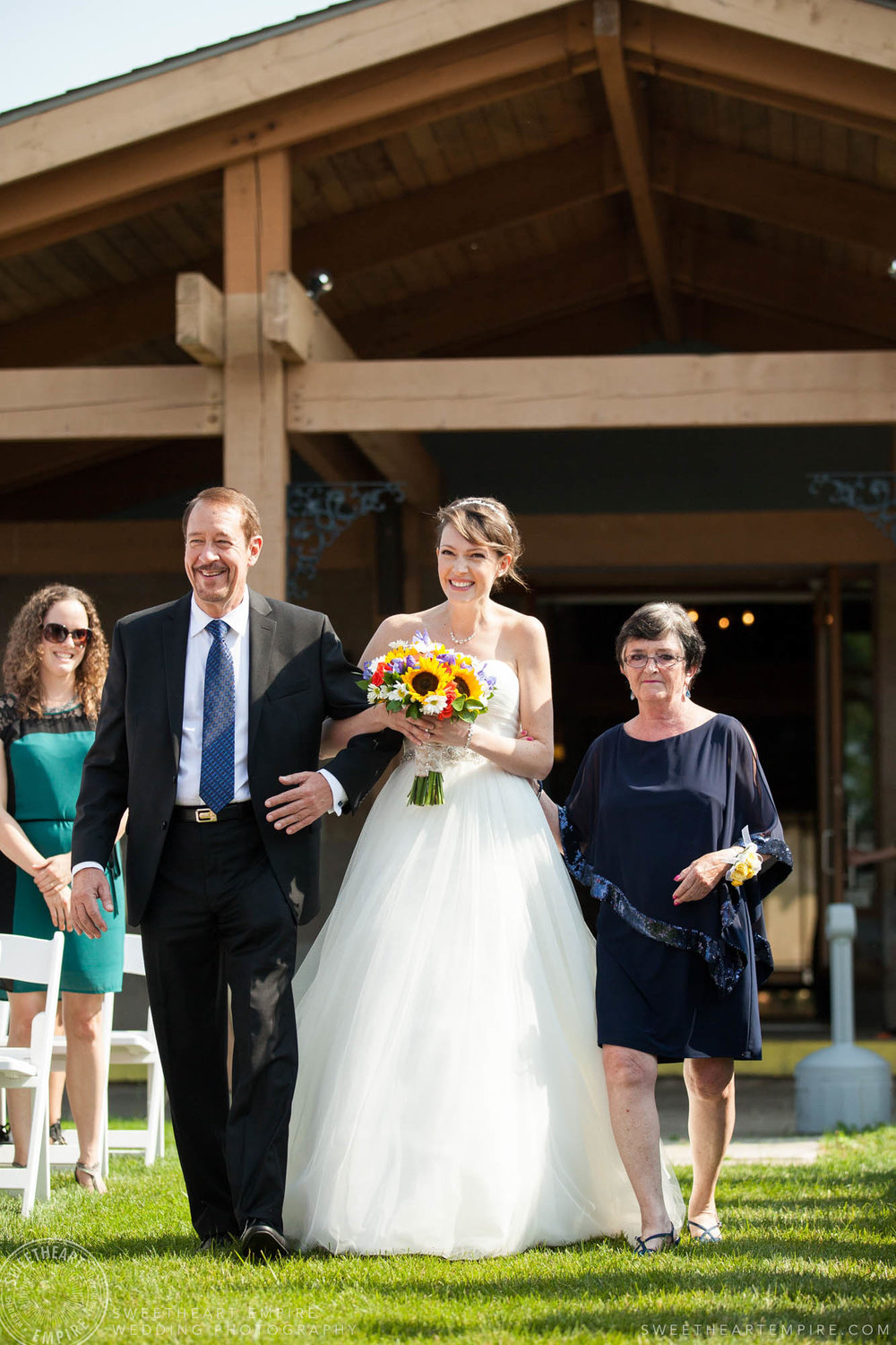 Bride walking down the aisle with her parents, Rockway Vineyard Wedding, Niagara