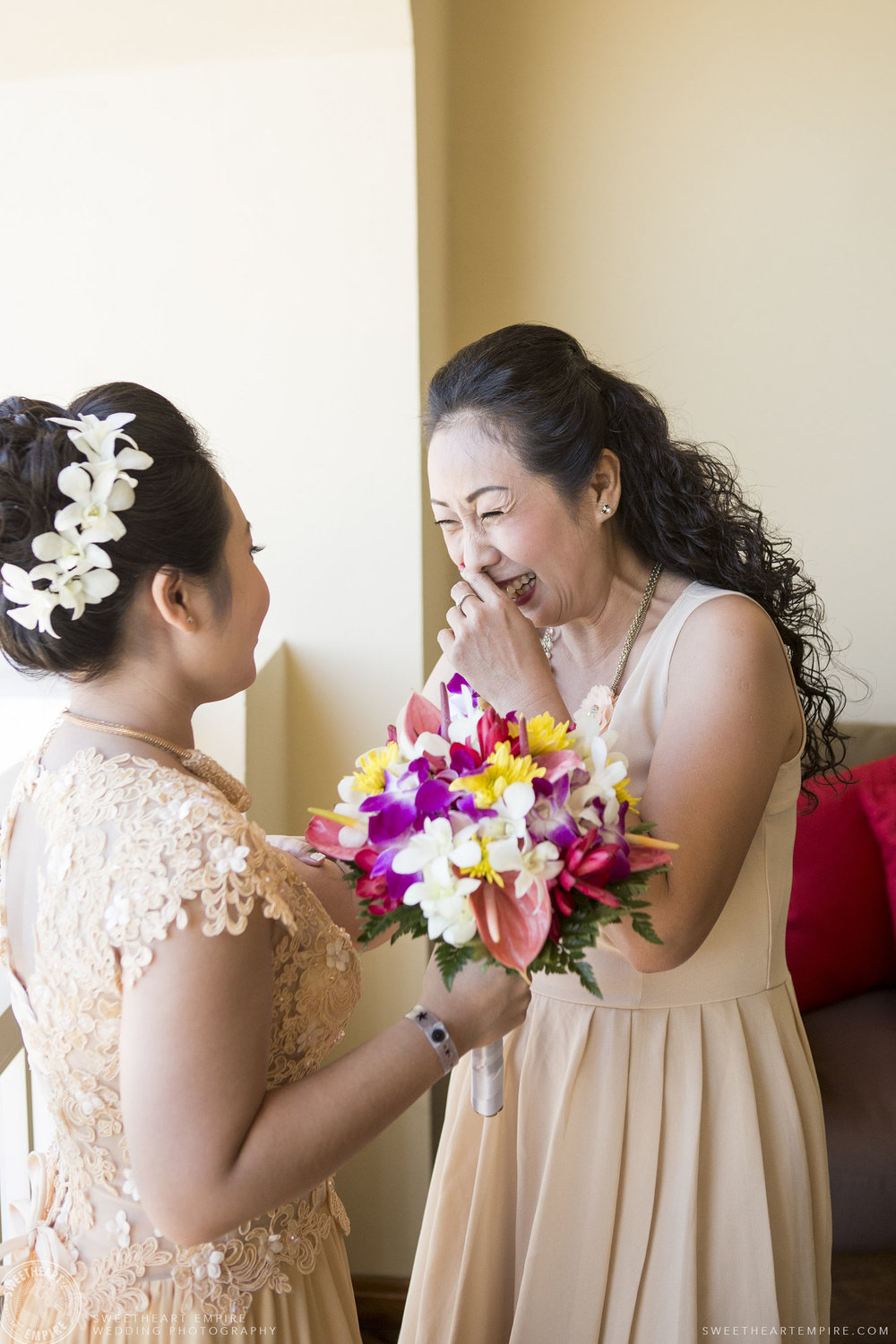 Bride sharing a laugh with her mom; Iberostar Grand Hotel Rose Hall, in Montego Bay, Jamaica