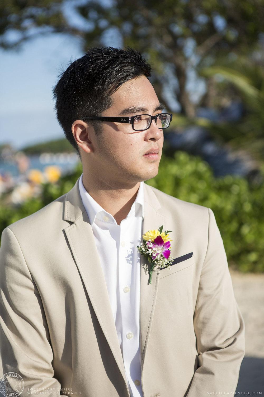 16_Emotional Groom at wedding on the beach.jpg