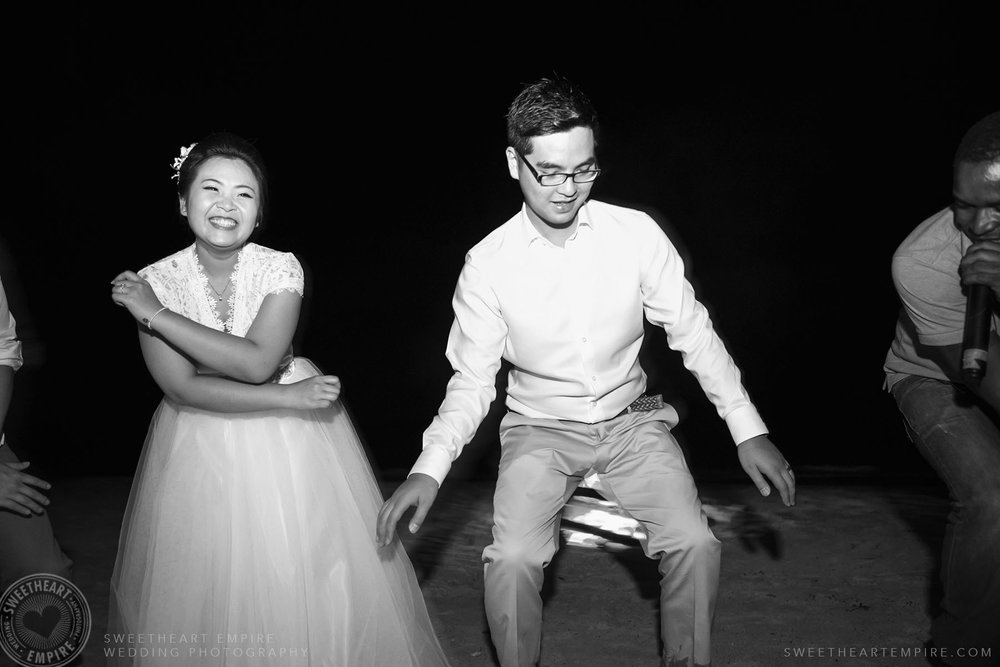 36_Bride and groom partying on the beach at night.jpg