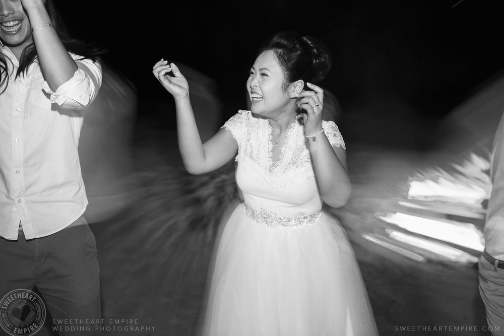 38_Bride dancing on the beach at night.jpg