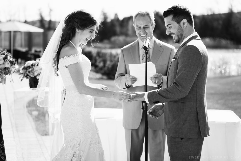 Bride and groom exchanging vows; Eagles Nest Golf Club Wedding Photos