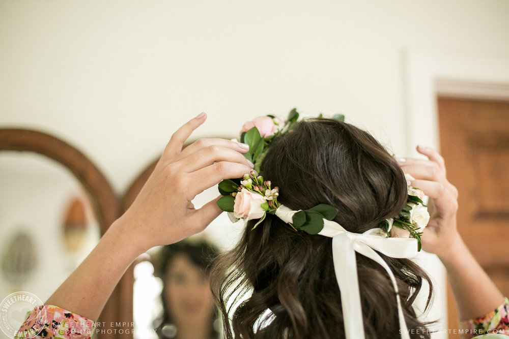 Bride adjusting her floral crown, Toronto Island Elopement