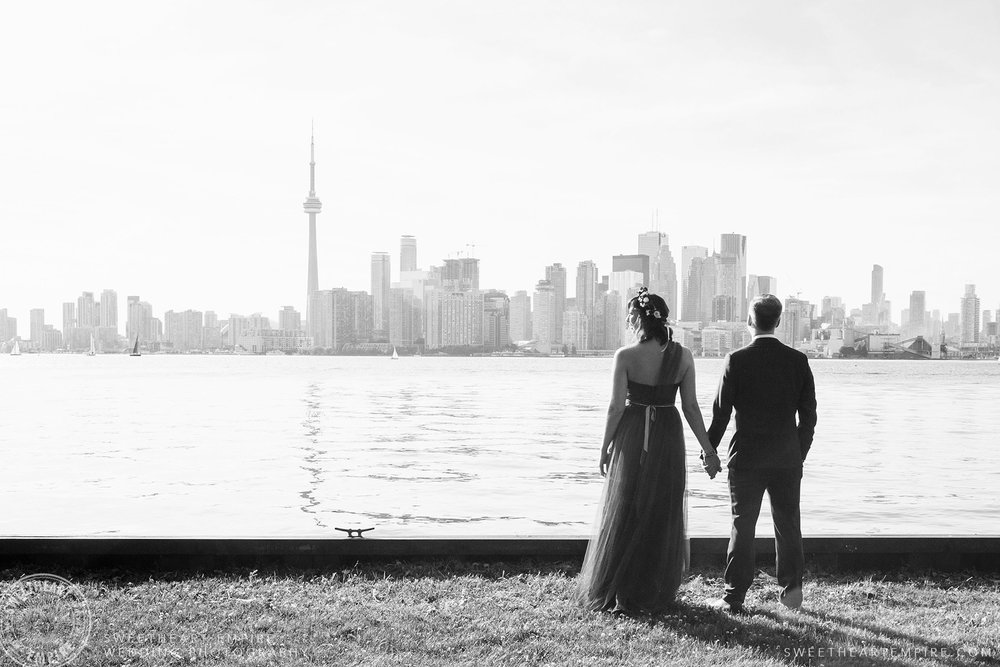 Bride and groom admiring the Toronto skyline, Toronto Island Elopement