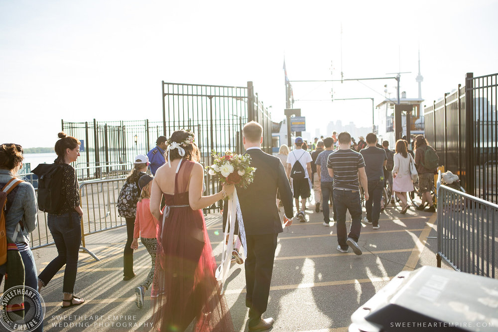 Bride and groom boarding the ferry back to Toronto, Toronto Island Elopement