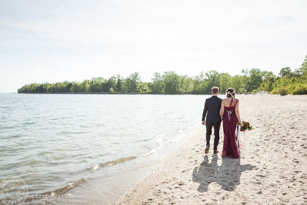 Newlyweds walking together along the beach, Toronto Island Elopement