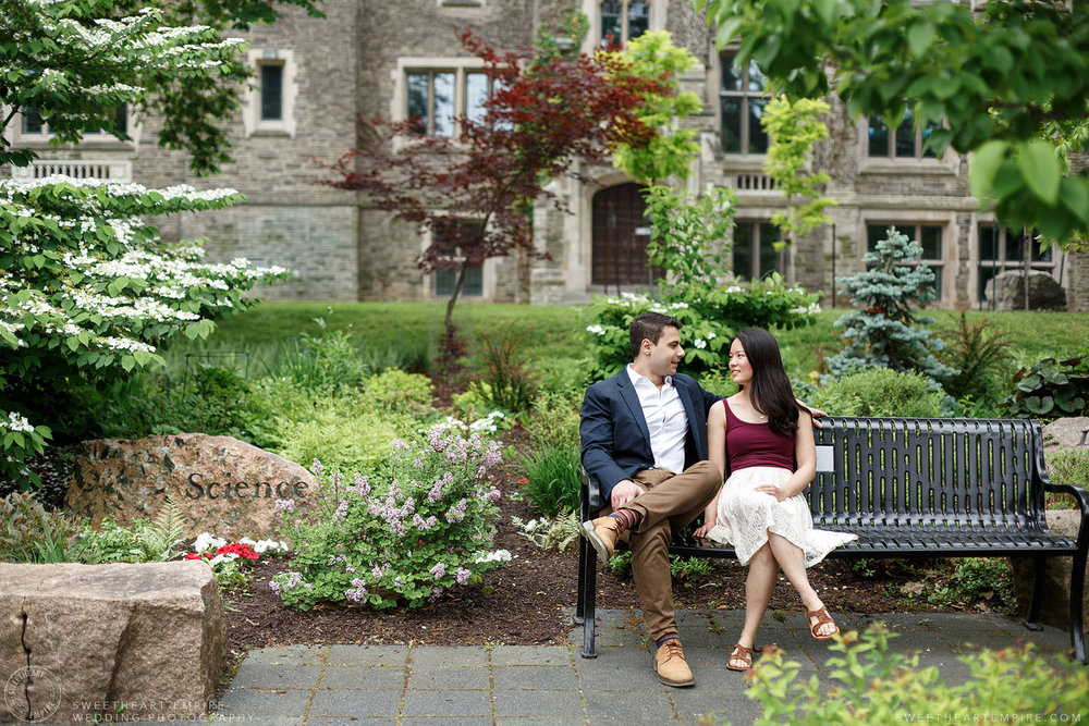 Couple sitting together in the gardens at McMaster University, McMaster University Engagement Session