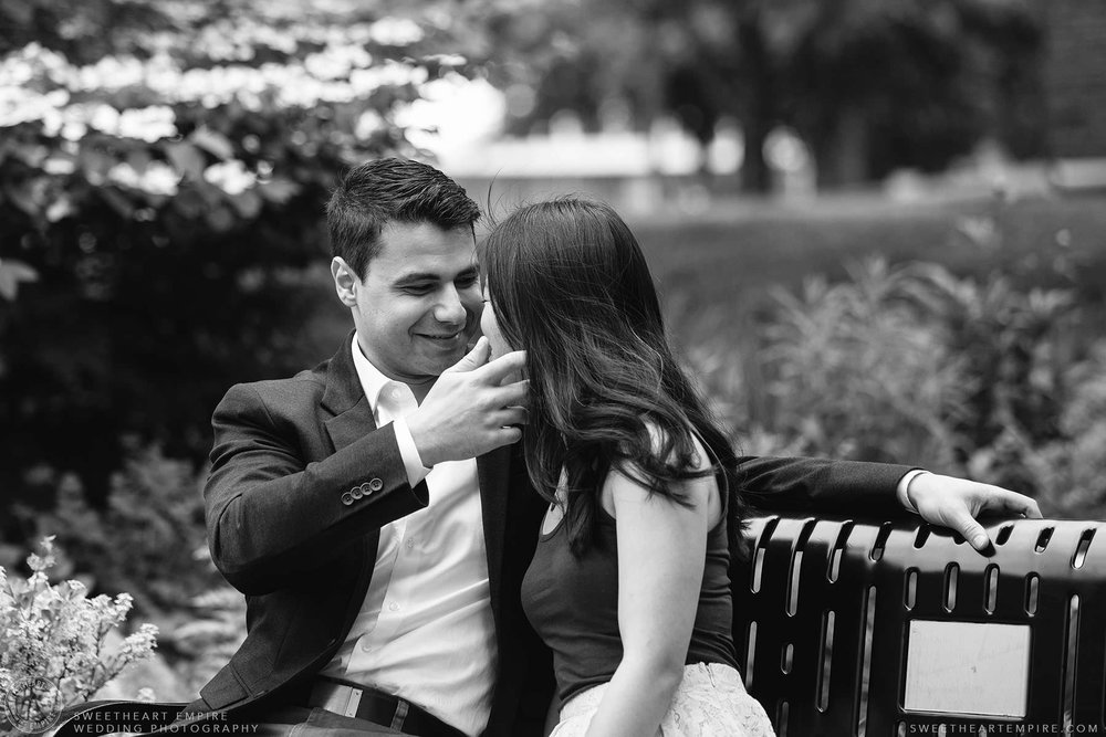 Groom to be smiles at his bride to be, McMaster University Engagement Session