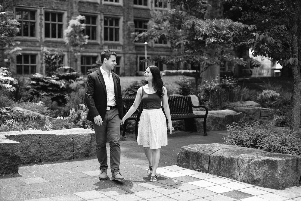 Couple walking together and holding hands, McMaster University Engagement Session