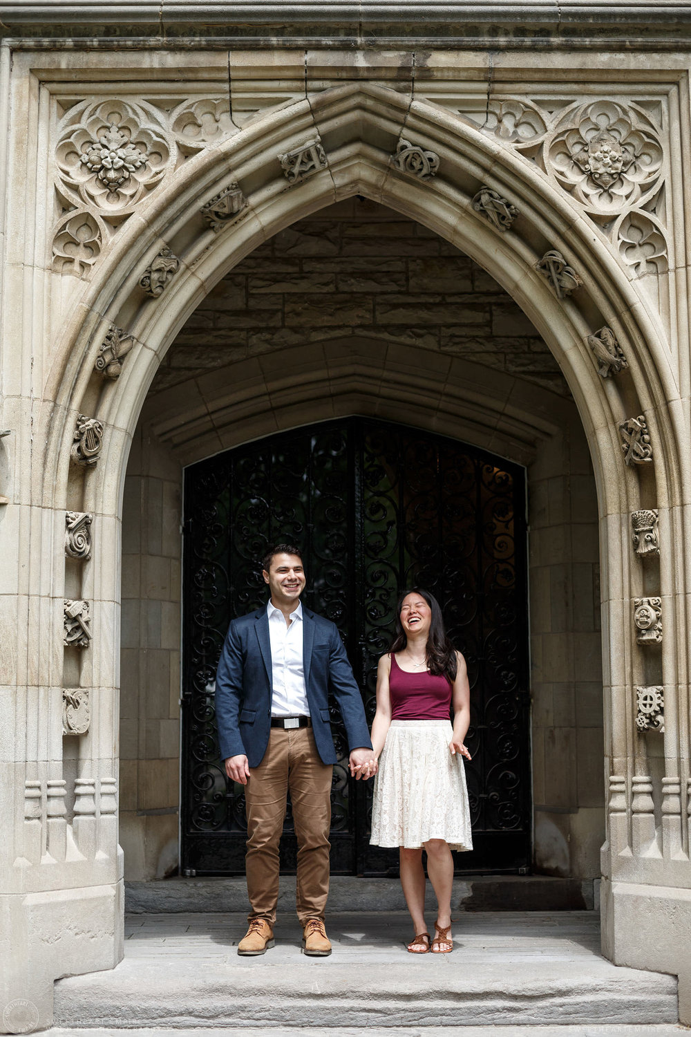 Couple holding hands and laughing together, McMaster University Engagement Session