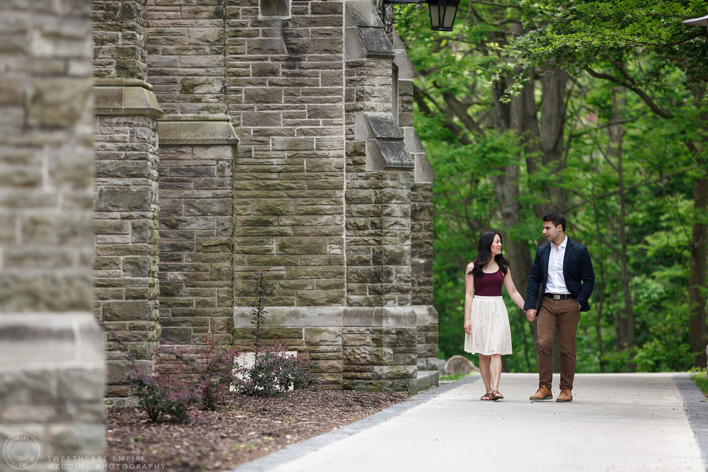 Couple walking together hand in hand, McMaster University Engagement Session