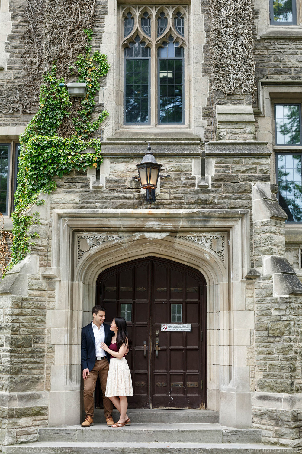 Couple standing together in doorway of building at McMaster University, McMaster University Engagement Session