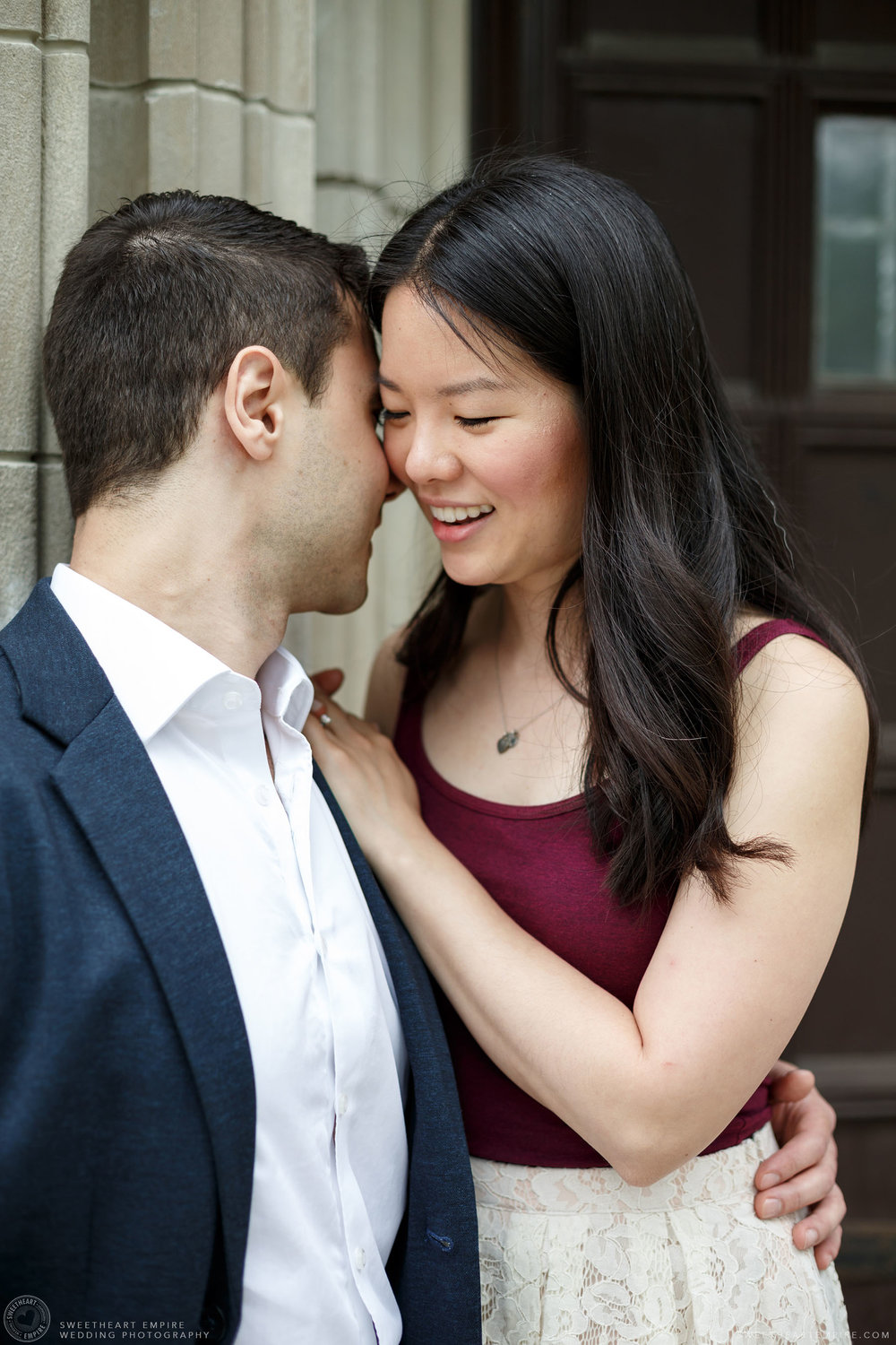 Couple sharing a close moment, McMaster University Engagement Session