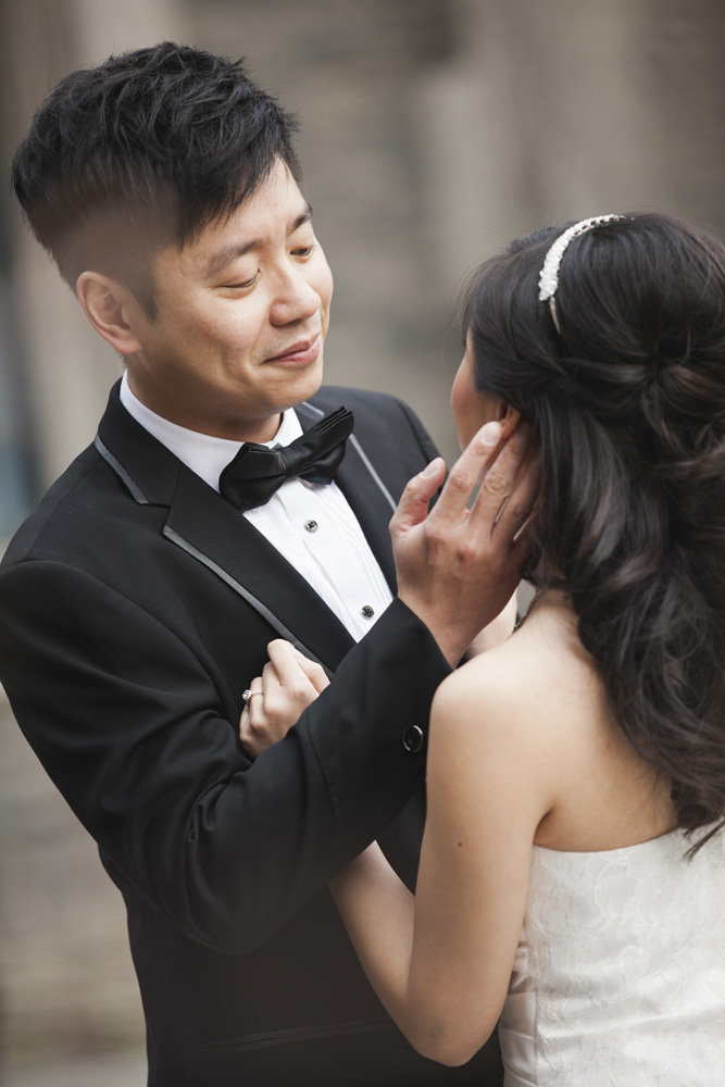 Groom caressing bride's face, Bayview Golf & Country Club Wedding