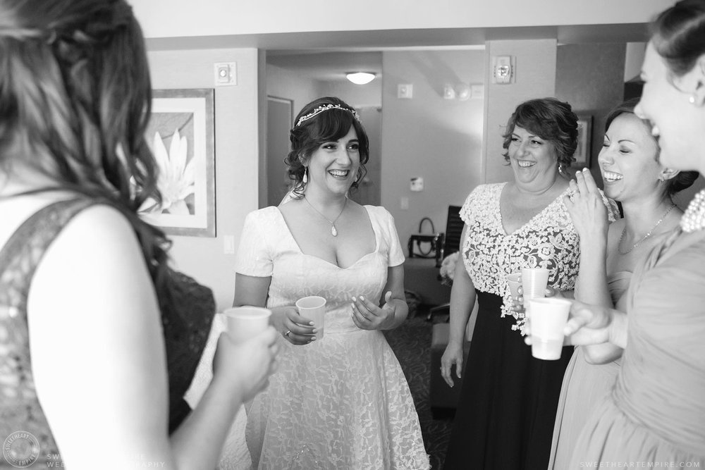Bride sharing a laugh with her mother and bridesmaids; Aberfoyle Mill Wedding