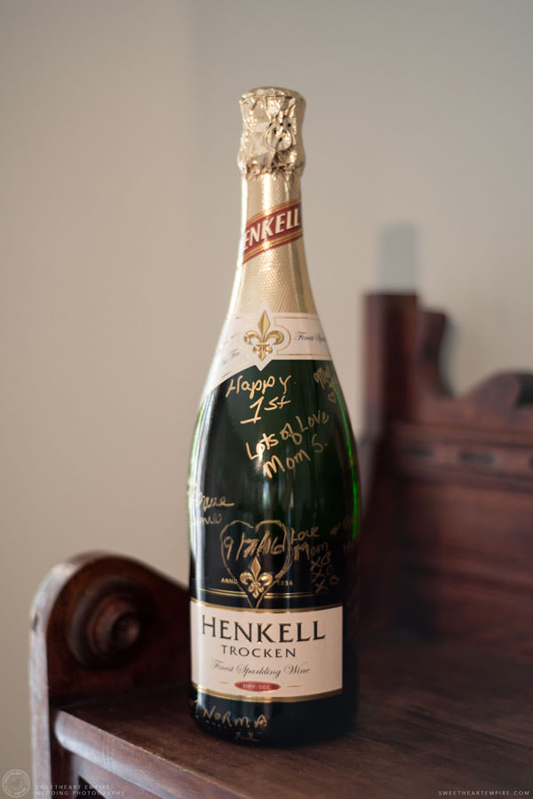 Bottle of champagne at the groom's house; Aberfoyle Mill Wedding