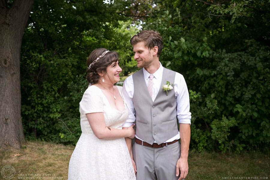 Bride and groom holding hands; Aberfoyle Mill Wedding