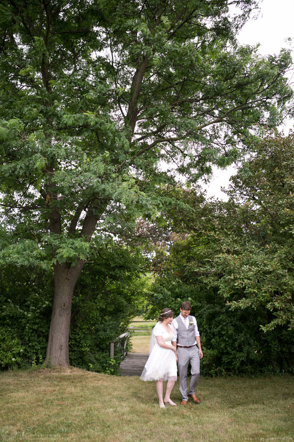 Bride and groom holding hands and walking together; Aberfoyle Mill Wedding